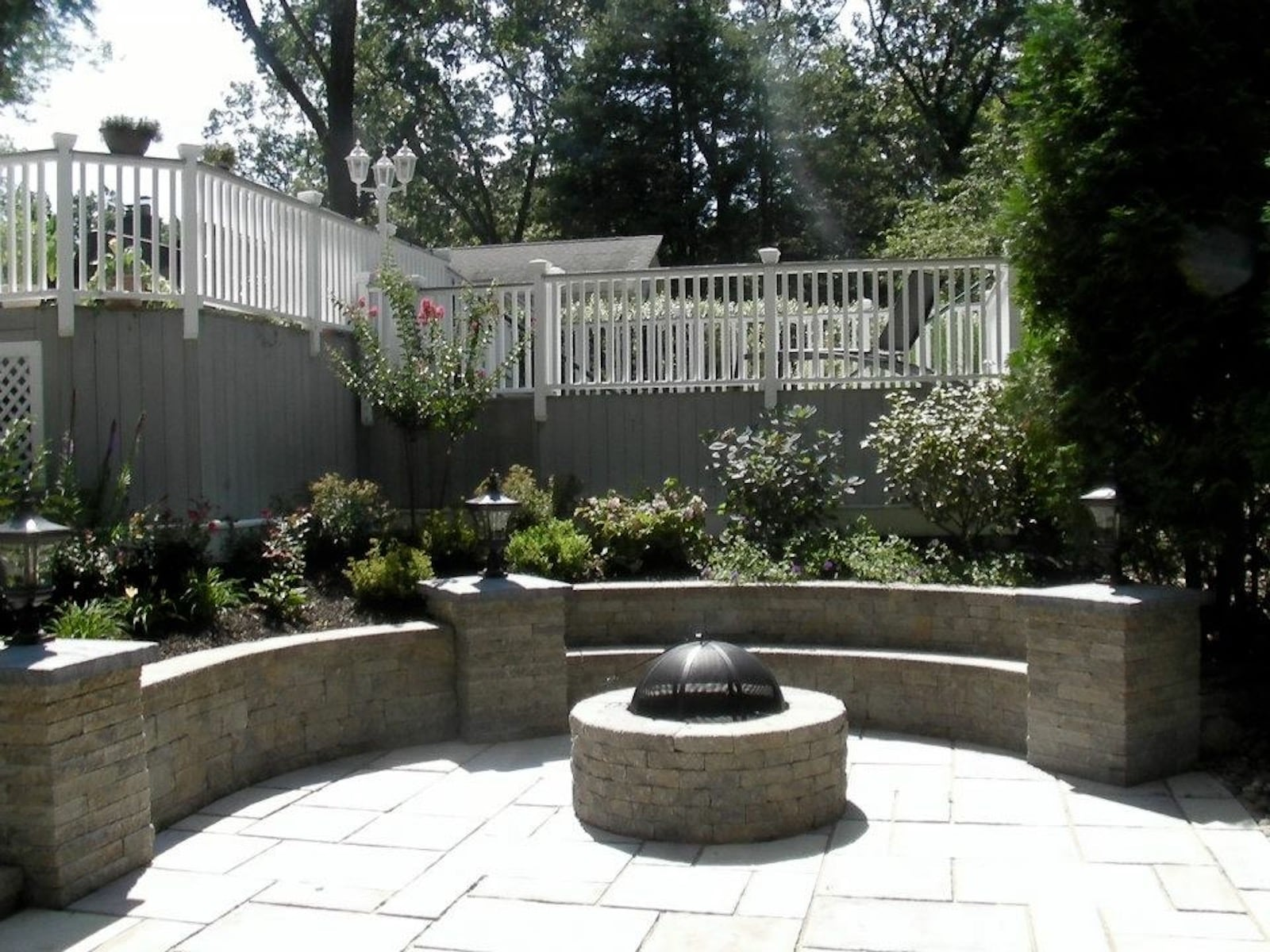 Outdoor Fire Pit and Patio by Primo Landscape Design